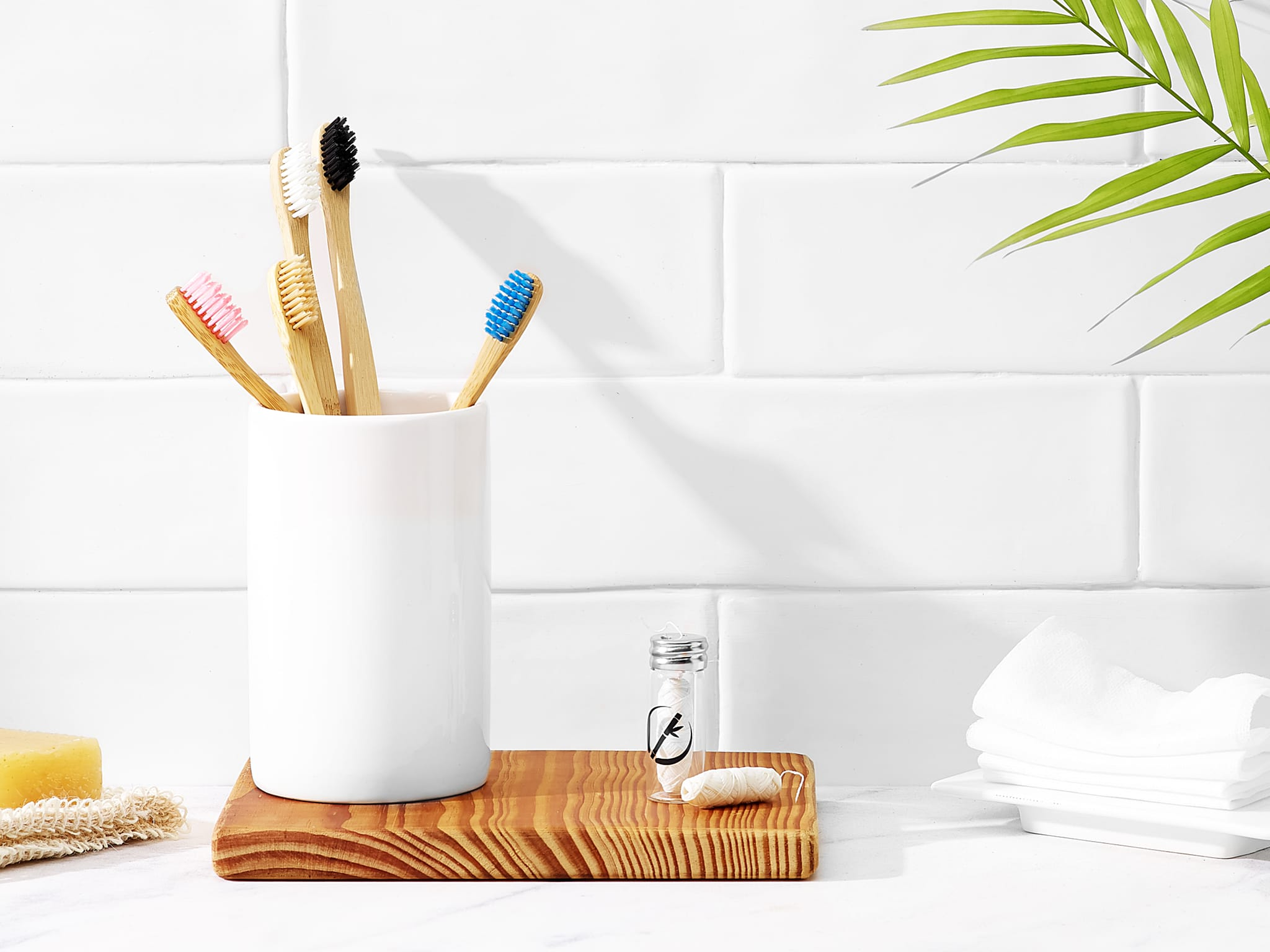 Product photography for Planet Bamboo of bambu toothbrushes and dental floss