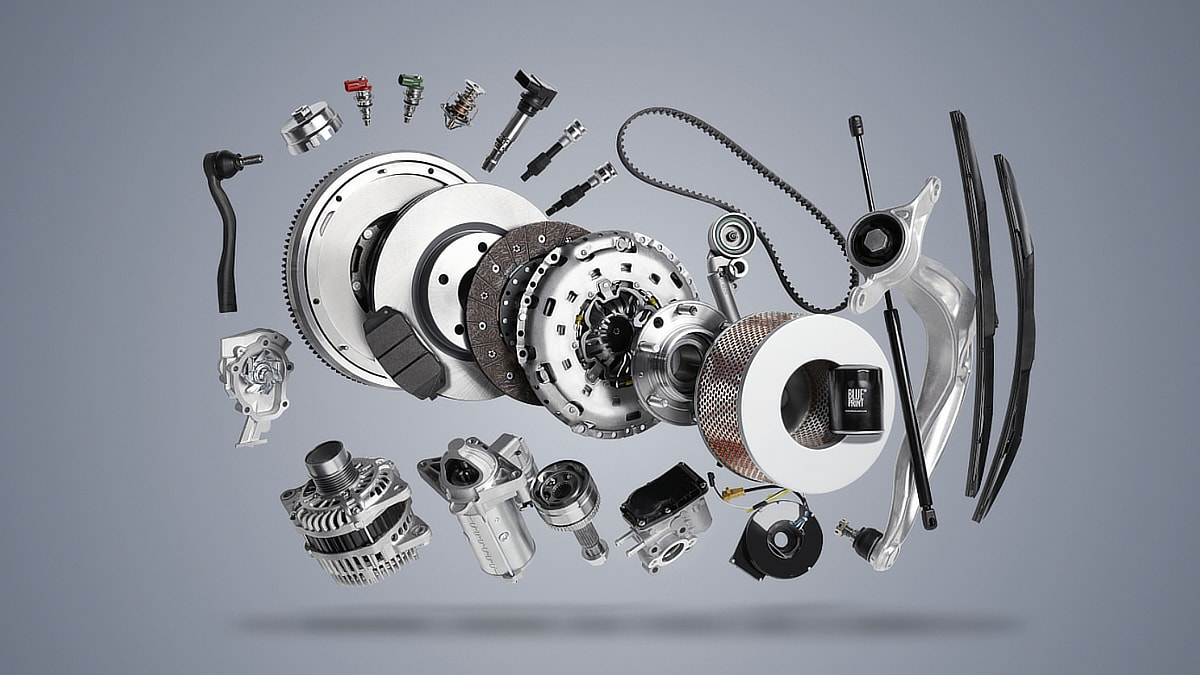 Advertising photography of several car parts floating